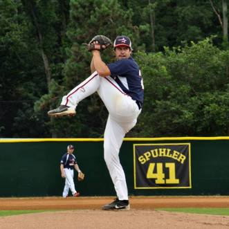 Technician Josh Morrison captured mid-pitch during WPFG baseball game. (Photo courtesy of Fairfax County Sheriff's Dept.)