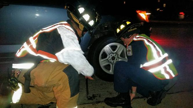 Firefighters Change Tire And Get Driver Out Of Harm's Way
