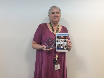 Mary Cramer, Life Safety Education, holding her award from NCS.